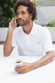 Man on the phone having coffee — Stock Photo