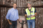 Warehouse manager and foreman working together — Stock Photo