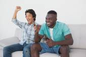 Soccer fans cheering while watching tv — Stock Photo