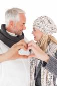 Mature couple forming heart with hands — Photo