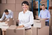 Warehouse workers packing up boxes — Foto de Stock