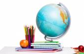 Pupils desk with books and globe — Stock Photo