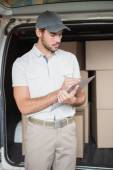 Delivery driver checking his list — Foto de Stock