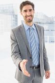 Businessman offering to shake hands — Stock Photo