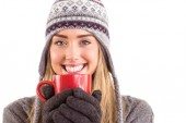 Happy blonde in winter clothes holding mug — Stock Photo