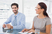 Businessman smiling in a meeting — Stock Photo