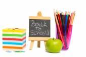 Black chalkboard with school supplies — Stock Photo