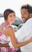Gorgeous couple smiling at camera — Stock Photo