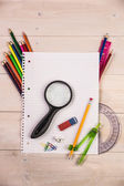 Students table with school supplies — Stock Photo