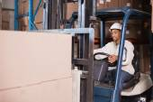 Forklift driver operating machine — Stock Photo