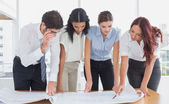 Business team reading work plans — Stock Photo