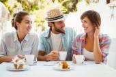 Happy friends enjoying coffee together — Foto de Stock