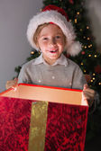 Child opening his christmas present — Stockfoto