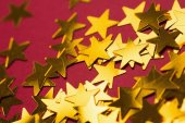 Golden star decorations spread out — Stok fotoğraf