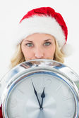 Attractive santa woman holding cropped clock — Stockfoto