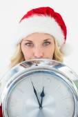 Attractive santa woman holding cropped clock — Stock Photo