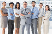 Serious workers standing all together — Stock Photo
