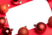 White page surrounded by christmas baubles — Foto Stock