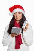 Shocked woman opening christmas present — Stock Photo