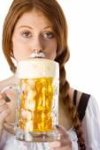 Oktoberfest girl drinking jug of beer — Stock Photo