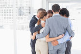 Business team all huddled together — Stock Photo