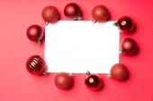 White page surrounded by christmas baubles — Stok fotoğraf