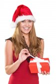 Festive blonde opening a gift — Stock Photo