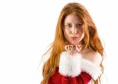 Festive redhead blowing a kiss — Stock Photo