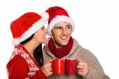 Young festive couple holding mugs — Stock fotografie