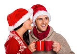 Young festive couple holding mugs — Стоковое фото