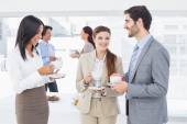Business people enjoying their drinks — Stock Photo