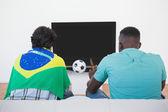 Brazilian soccer fans watching tv — Stock Photo