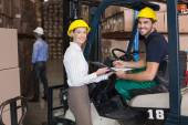 Warehouse manager with forklift driver — Stock Photo