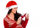 Young brunette with christmas present — Stock Photo