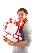 Man holding some large presents — Stockfoto