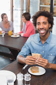 Handsome man eating a sandwich — Foto de Stock