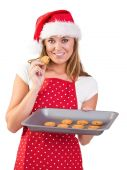 Festive homemaker showing hot cookies — Stock Photo