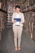 Pretty warehouse manager using tablet pc — Photo
