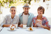 Happy friends enjoying coffee together — Stock Photo