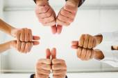 Multiple hands giving thumbs up — Stock Photo