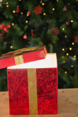 Light shining from christmas present — Zdjęcie stockowe