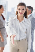 Smiling business woman offering handshake — Foto de Stock