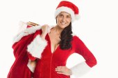 Woman smiling with christmas presents — Stockfoto