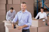 Warehouse workers packing up boxes — Stock Photo