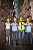 Warehouse team showing thumbs up — Stock Photo