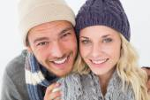 Attractive young couple in warm clothing — Stock Photo