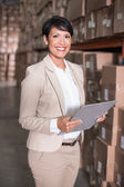 Pretty warehouse manager smiling at camera — Stock Photo