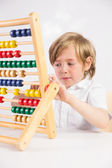 Student doing maths on abacus — Stock Photo