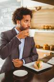 Businessman enjoying his lunch hour — Stock Photo