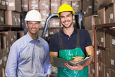 Warehouse manager and foreman smiling — Stock Photo